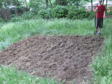 After nearly 4 hours of digging (with a 1/2 hour supper break), The Happy Teenager was glad to pose for a picture and show off what he got done.